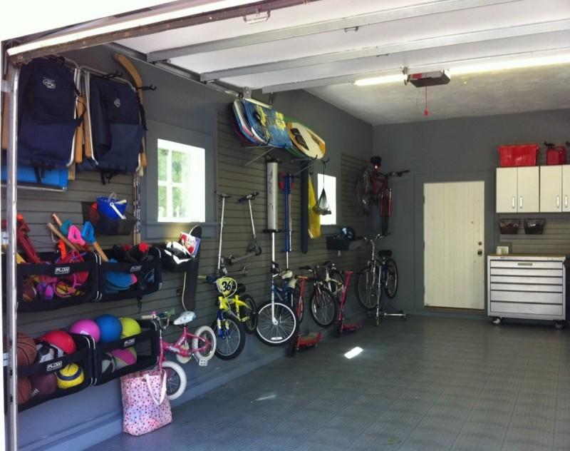 modern garade idea with metal cabinets bins shelves and hooks