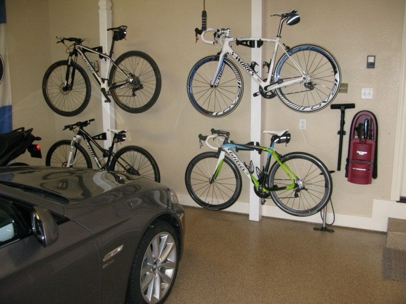 modern garage design supported with wall mounted garage vac slat wall storage for bikes brown Epoxy coating floors