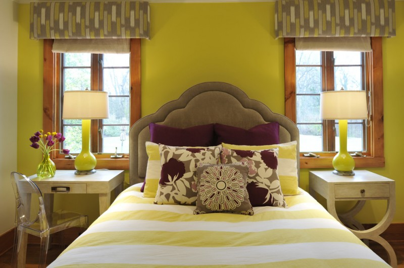 modern girls bedroom idea mustard walls bed frame with dark brown headboard white yellow strippes bedding treatment plum purple pillows clear acrylic studying chair pale toned wood bedside tables