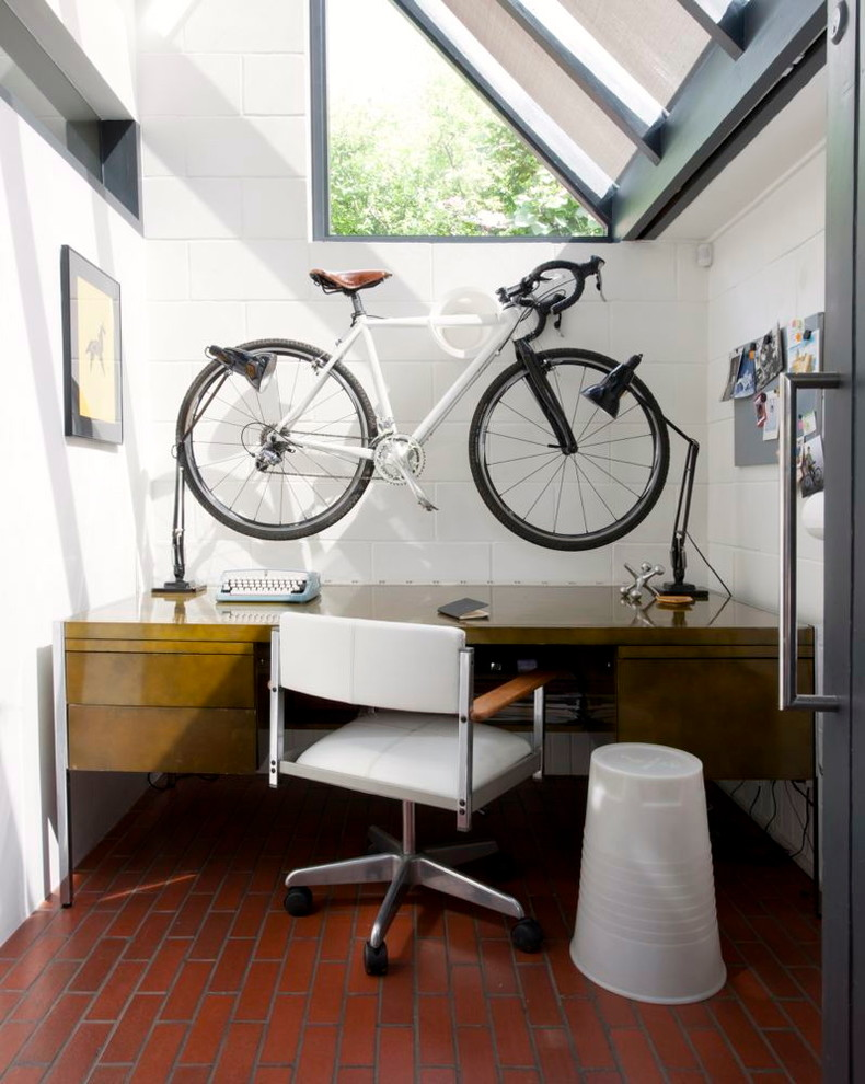 modern home office idea ornamental mounted wall bike hardwood working table modern working chair with wheels white ceramic walls terracotta tiles floors