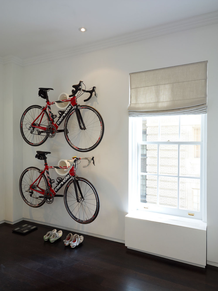 modern minimalist hallway a couple of hanging bikes darkwood floors white walls