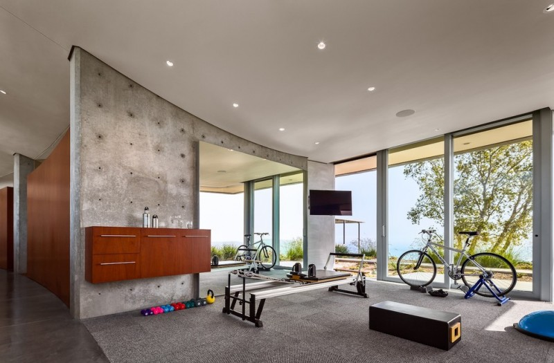 modern minimalist home gym with concrete interior clean lines wood cabinet in floating installation kickstand for bike