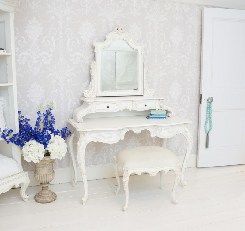 pure white makeup vanity table in French style French style vanity chair in white shabby antique vase with colorful flowers