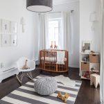 Simple Modern Nursery Idea White Walls White Window Curtains Medium Toned Wood Crib In Round Shape Mid Century Modern Rocking Chair In White Stripped Rug Dark Toned Wood Floors
