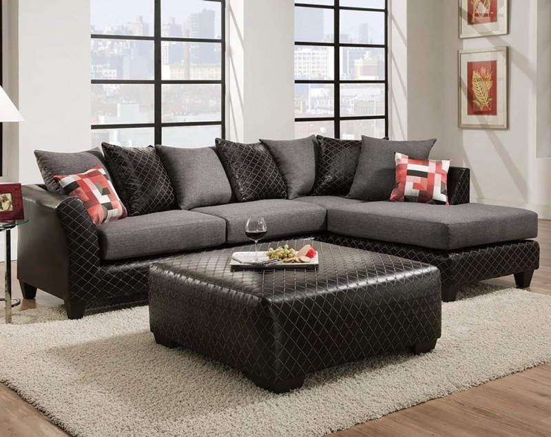 sleeper sofa with black leather showcase and facing chaise black leather ottoman coffee table light grey area rug medium toned wood floors