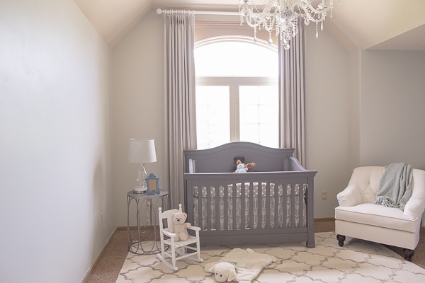 soft neutral nursery idea grey baby crib grey window curtains light grey walls white nursery chair grey finished side table small white chair white rug with grey motifs