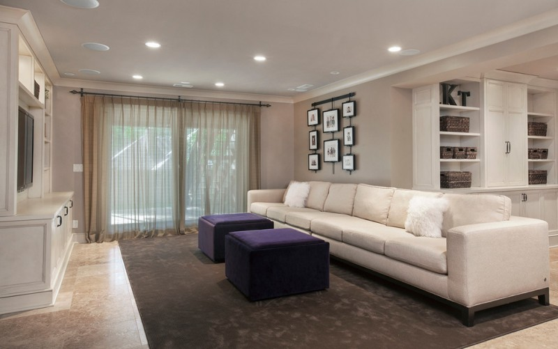 traditional basement idea semi transparent window curtains in golden beige long white sectional with fury accent pillows dark purple center tables black doff carpet