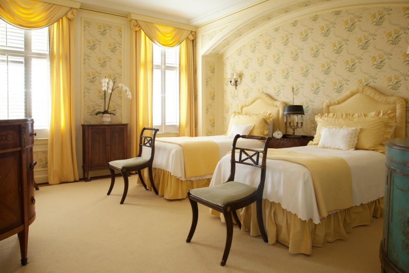 traditional guest bedroom idea mustard wallpaper a couple of traditional bed frame with mustard headboard dark wood chairs soft mustard carpet yellow window curtains