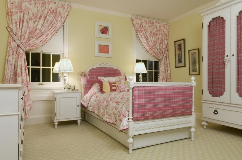 traditional kids' bedroom idea light mustard walls pink draperies white wardrobe storage with deep pink front door traditional bed frame with headboard white bedside tables