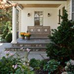 Traditional Porch Design White Siding Exterior Walls And Pillars Concrete Floors Custom Wood Bench With Back A Couple Of Wall Lamps