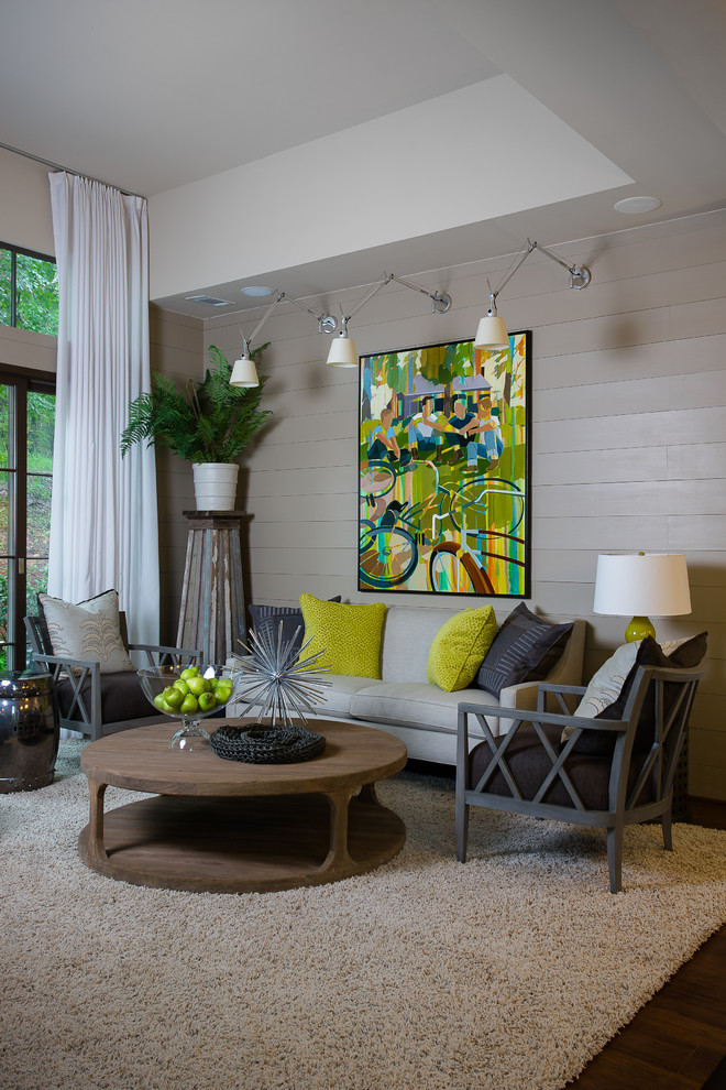 transitional living room idea three units of spotlights supported by metal holders grey siding walls grass look like carpet grey seats yellow accent pillows dark toned wood floors