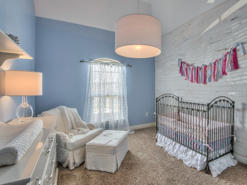 unique concept nursery idea shabby white boards wall clean blue walls white nursery chair slipcover black stained iron crib with white skirt earthy brown rug