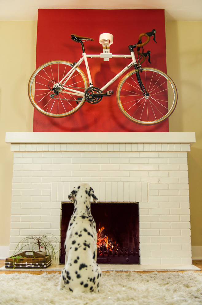 urban style room higher bike storage solution with red background wall standard fireplace with white brick surrounds