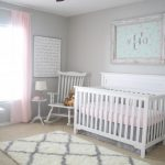 Vintage Style Nursery Idea White Baby Crib White Rocking Chair Baby Pink Window Curtains Grey Walls Light Brown Carpet White Fluffy Rug With Grey Accents