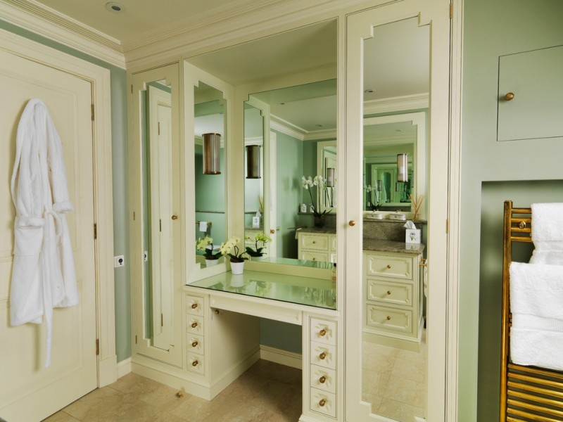 walk in closet with recessed glass top makeup vanity frameless mirror