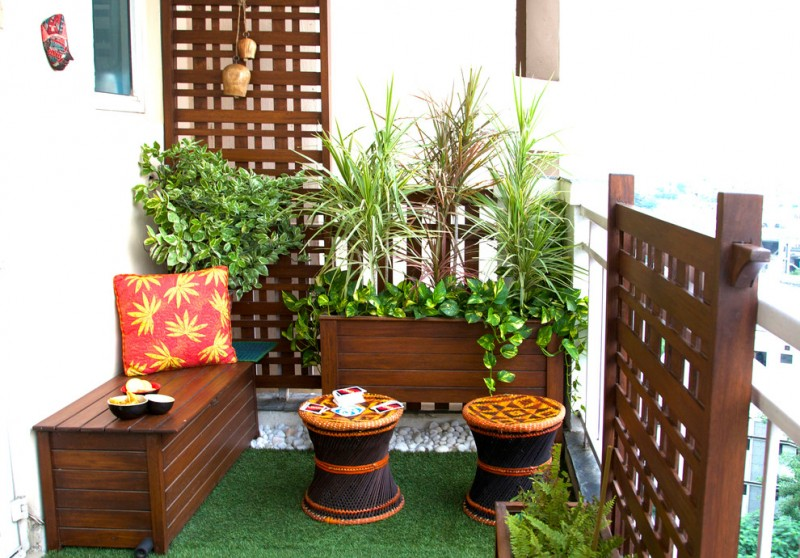 Asian style balcony for two dark finishing loveseat bench a couple of side chairs with Asian motifs synthetic gree grass carpeting dark finishing wood partitions