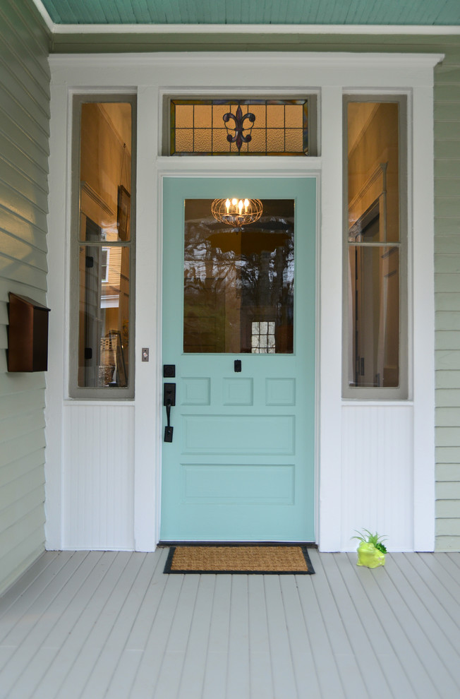 classy blue colonial style front door with sidelights and central window accent white grey siding exterior walls grey siding floors