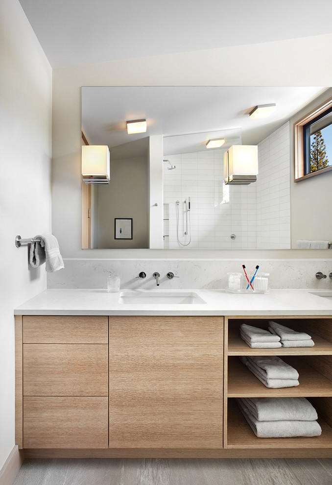 clean lines & modern bathroom vanity with wood cabinets and open shelves large frameless vanity mirror modern light fixtures mounted on mirror