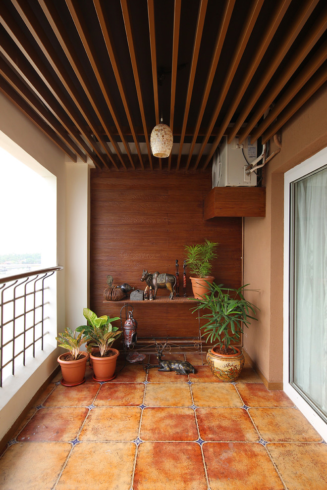 contemporary balcony idea shabby clay burnt planters small side table with decorative sculptures shabby orange tiles flooring hardwood walls exposed beams ceilings