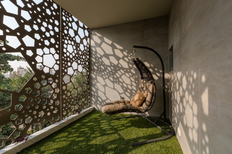 contemporary balcony with pentagons enclosure concrete walls synthetic green grass carpeting modern swing