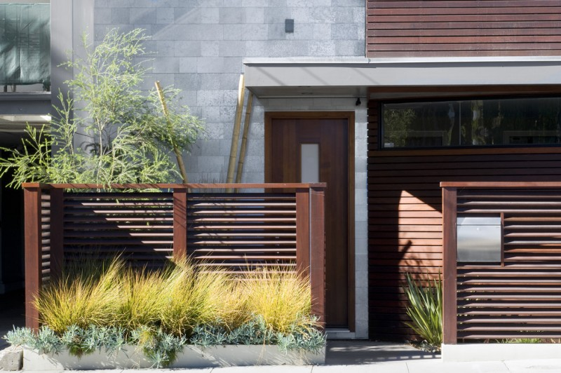 contemporary exterior idea single front door in dark finishing color dark toned wood siding exterior walls grey exterior walls modern wood fences idea