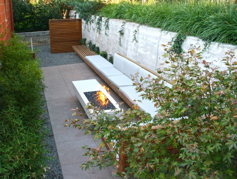 contemporary patio patio idea integrated with modular cushion fire pit table concrete decking idea wood slats divider for outdoor shower