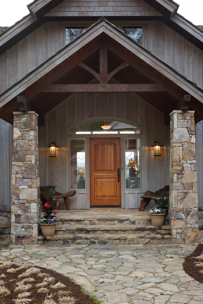 contemporary rustic exterior with wood colonial front door accented by sidelights on either side