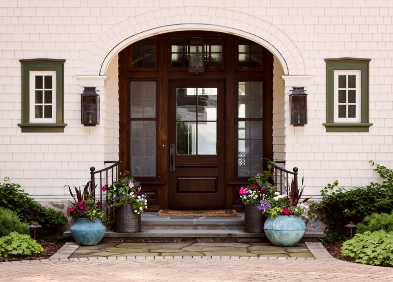 farmhouse style entryway dark finishing colonial front door with semi blurred glass sidelights white painted wood shingles exterior walls