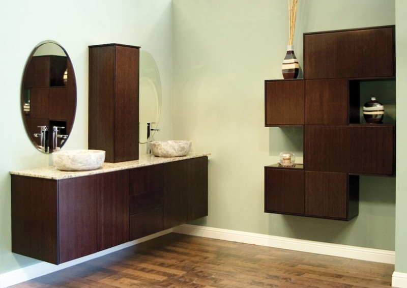 floating modern bathroom vanity with chocolate bamboos finishing cabinets marble countertop and sinks oval shaped vanity mirror vertical closet addition