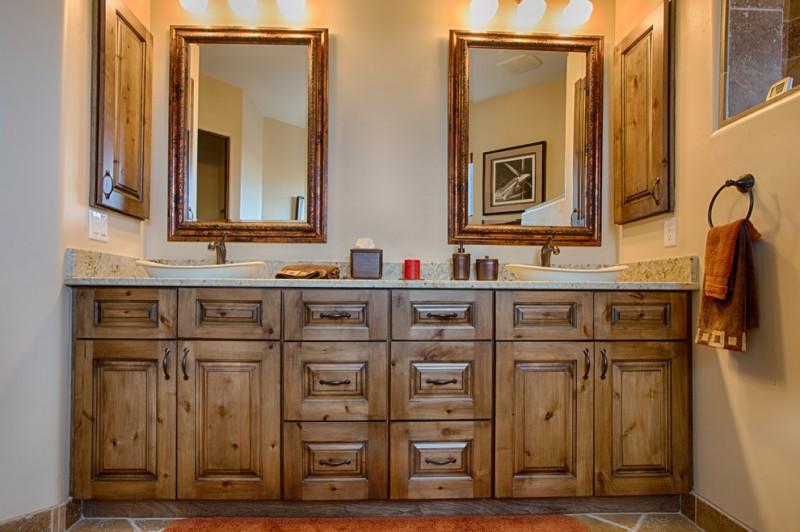 grand wood bathroom vanity solid wood cabinets with raised panels wood framed mirrors top vanity lamps granite countertop vessel sinks