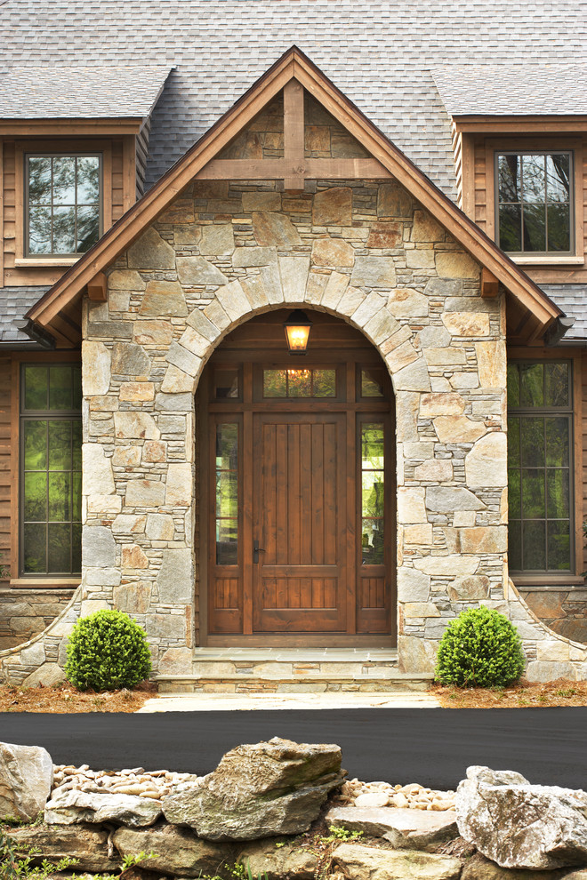 hardwood colonial front door with rustic appeal stone walls