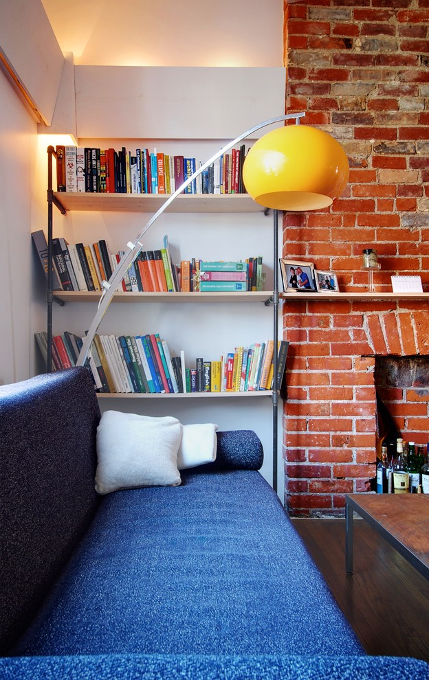industrial home library with half way bricks walls and white painted concrete walls simple black iron book shelves