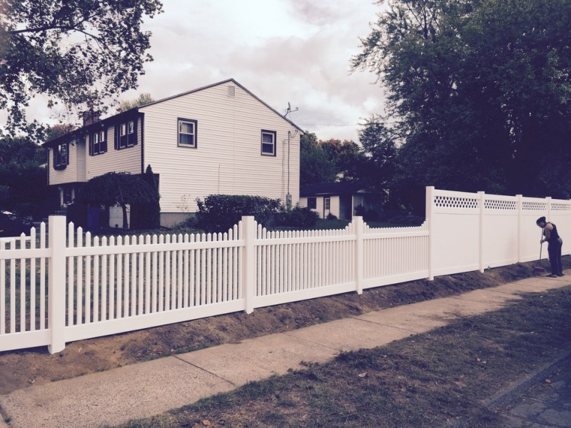 landscape idea for farmhouse style exterior mix fences idea consisting of white lattice fences and white wood board fences