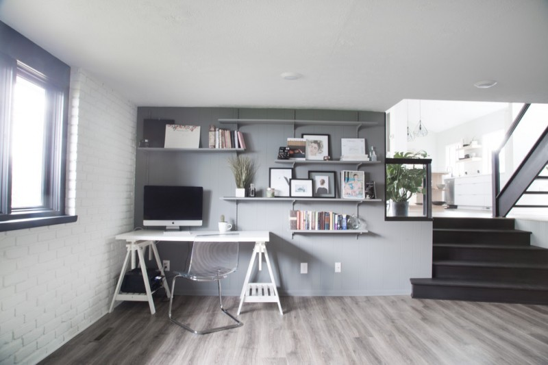 large home office large wall shelves idea in grey white working desk modern silver toned working chair grey walls grey wood floors