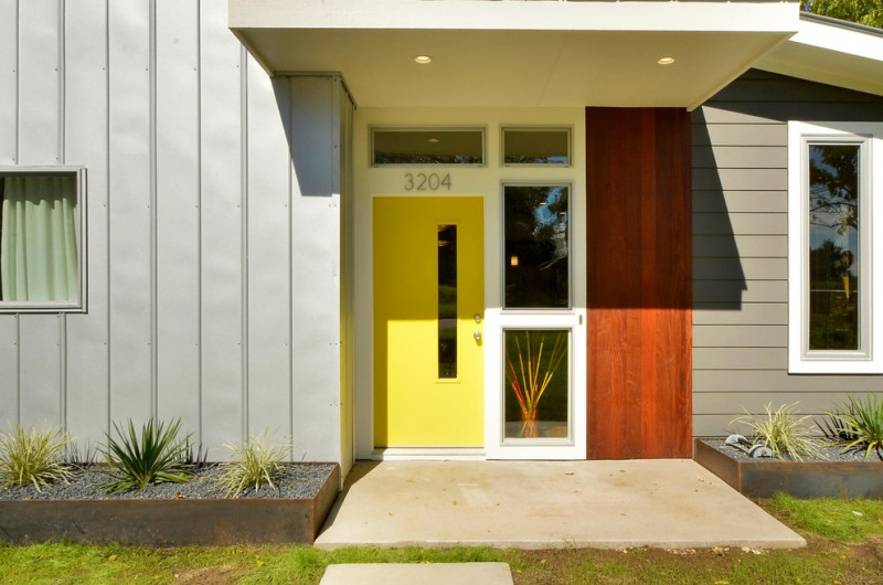 mid century modern entryway modern colonial front door in yellow with narrow glass panel glass windows with white trims