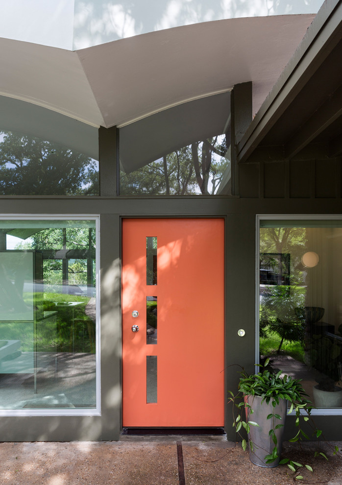 mid century modern front door idea in orange black doff exterior walls frameless glass windows