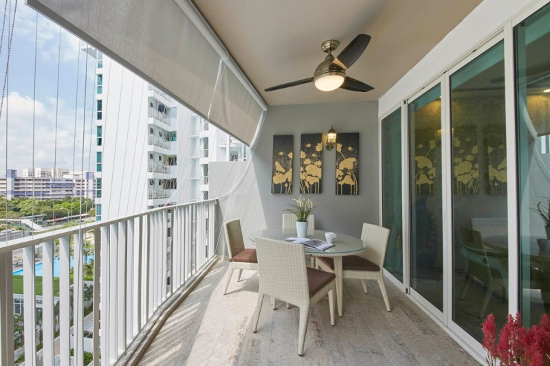 modern balcony dominating by white modern outdoor furniture set ceiling fan with central lighting three unique wall arts whitewashed wood floors grey painted walls