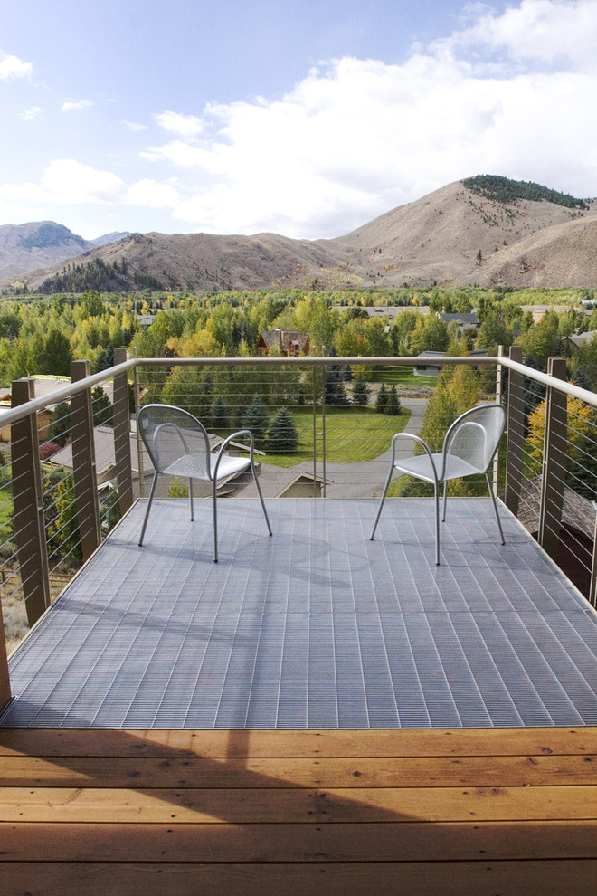 modern balcony for mountain houses metal decking idea cables rails supported by bigger metal bar rail posts a couple of chairs