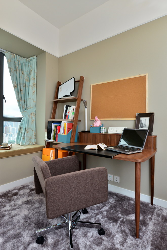 modern home office design dark toned working table movable working chair in dark brown orange colored wall board organizer wood ladder shelving unit