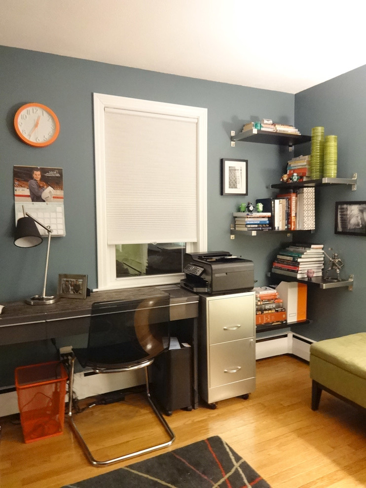 modern home office grey walls medium toned wood floors small sized floating shelving units modern freestanding working table black acrylic working chair