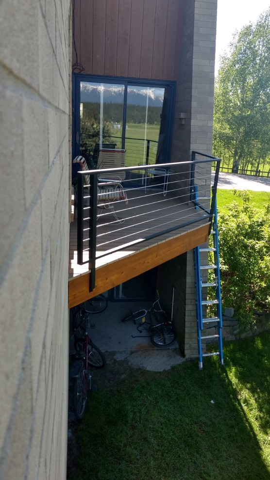 narrow contemporary balcony idea cable rails and black stained metal rail posts blue painted steel ladder