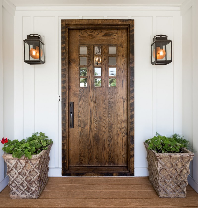 rustic colonial front door for farmhouse exterior white exterior walls rustic style wall sconces wood floors hard textured planters