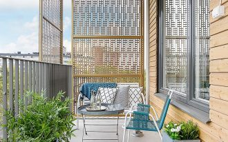 scandinavian balcony design with unique wood partitions wood siding exterior walls white laminated floors small sized area rug in blue white blue white chairs
