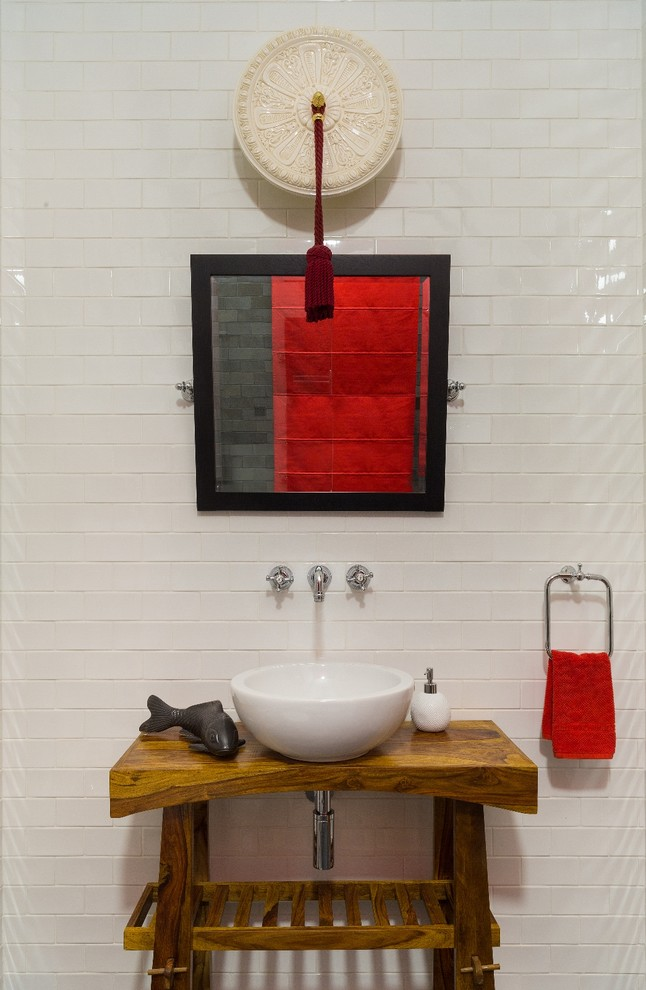 small bathroom vanity idea solid wood countertop white sink white subway ceramic tiles walls artistic wall decor