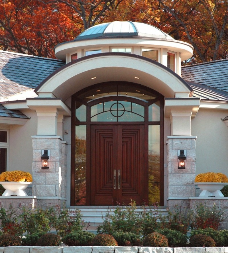 traditional exterior design with modern elements huge hardwood colonial front door with huge glass sidelights and transom arched roof