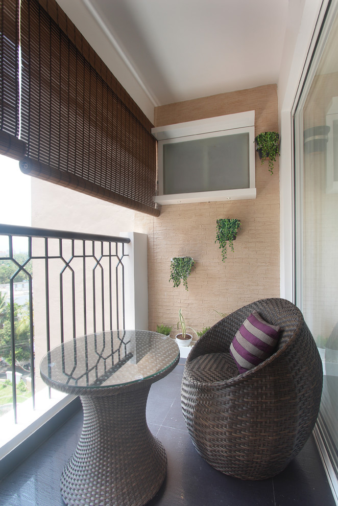 transitional balcony idea modern rattan chair with accent pillow round shaped rattan table with glass top bamboos shutters iron railing system light brown tiles walls with wall mounted greens