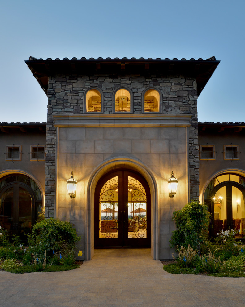Mediterranean exterior with traditional wall sconces