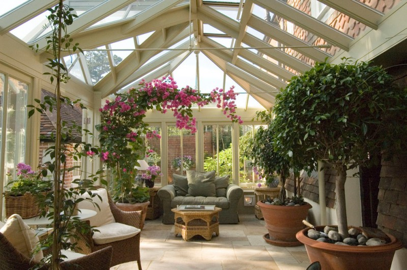 botanical garden look like sunroom idea grey loveseat medium sized clay burnt planters medium sized decorative plants