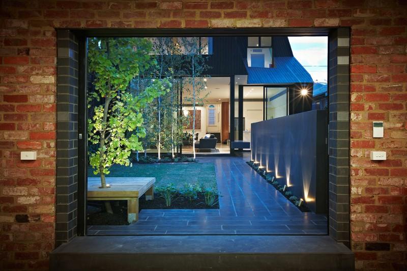 contemporary interior garden idea spotlight fixtures against grey walls tiles floors