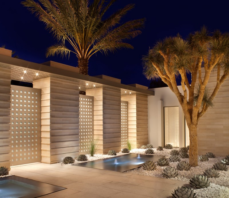contemporary landscape idea with contemporary exterior walls recessed lighting fixtures water fountain lighting fixtures white natural stones suculents paving pathway large palm trees
